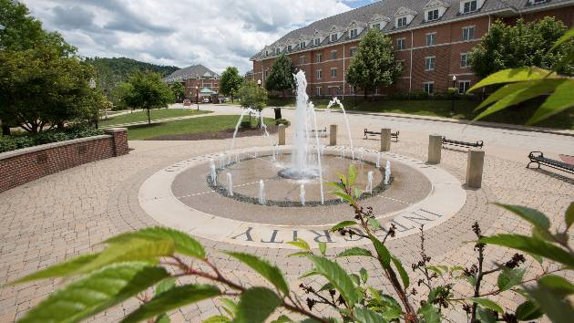 A fountain shoots water on a hot day at Cal U campus.