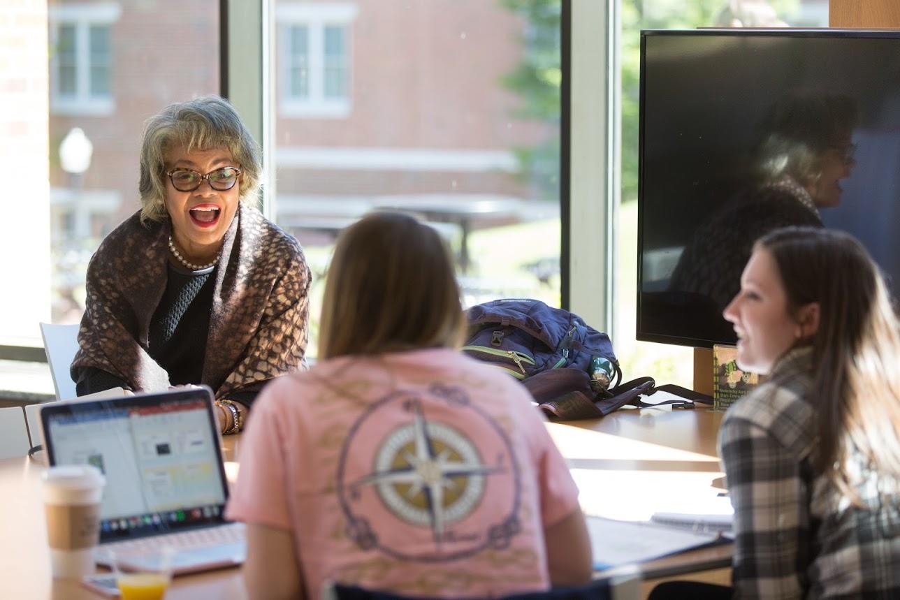 President Jones talks with student in Natali Student Center.