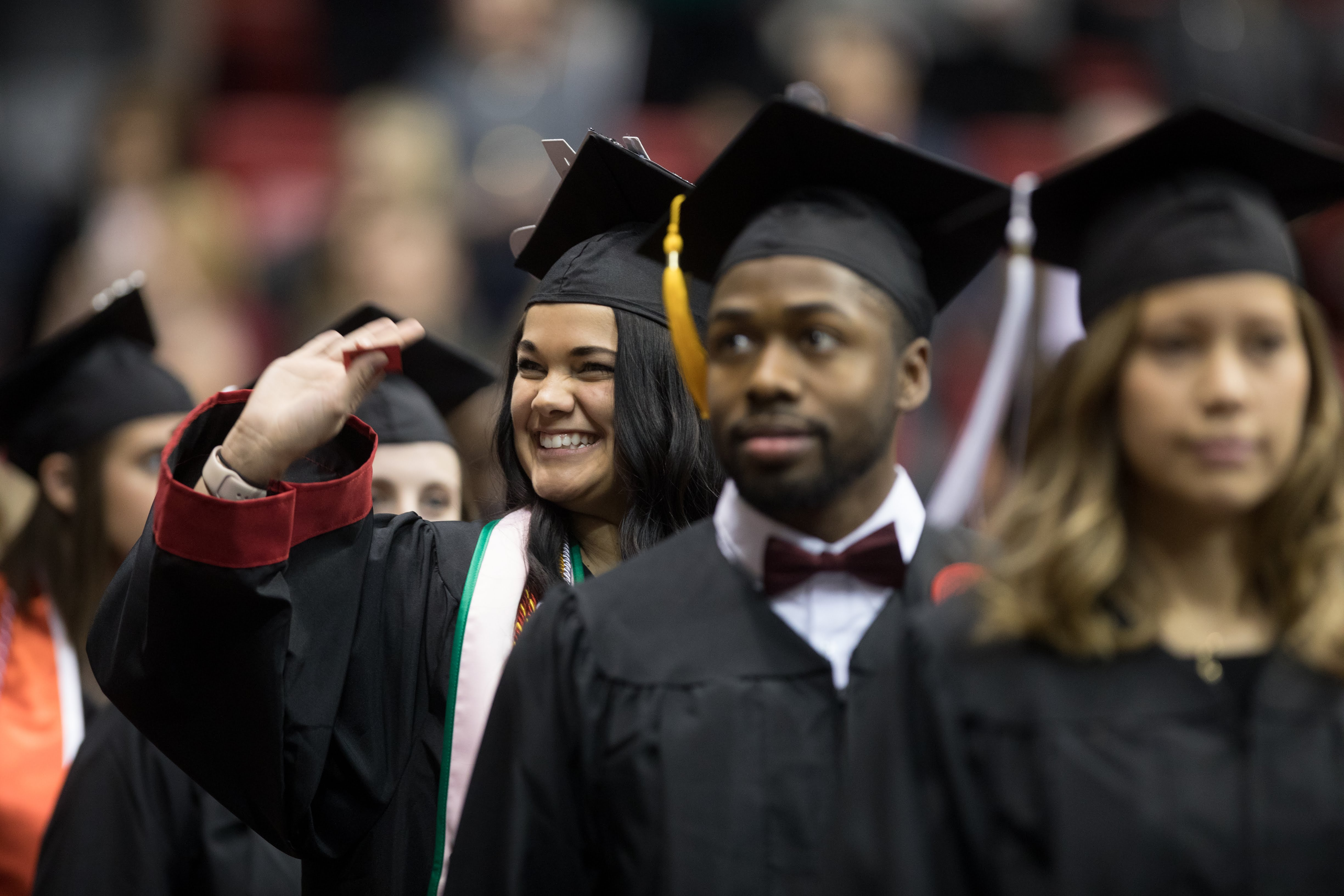 A student wearing a cap and gown during Commencement at Cal U.